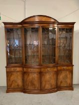 A large satin wood display cabinet with pediment top glazed doors and cupboard under (2parts) (