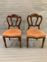 A pair of mahogany scrolled back seats