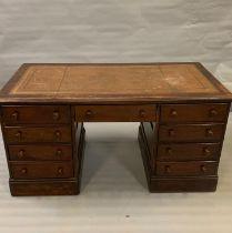A mahogany pedestal desk with leather top (H76cm W150cm D75cm)