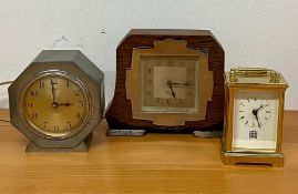 Two 1960's mantle clocks by Smith Sectric and Ferranti and one other