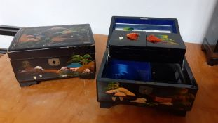 A pair of Chinese black lacquered jewellery boxes, fitted interior with mirror, (10x18x13 cm ). (2)