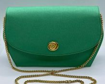 A vintage Jaeger green bag with dust cover