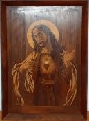 A representation of 'The sacred heart of Jesus' on inlay wood, (93x26 cm).