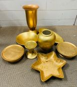 Eight gold coloured items for the home.