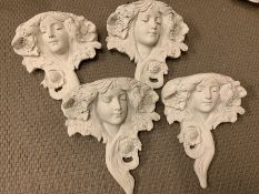 Four decorative wall mounted planters in the style of a goddess.
