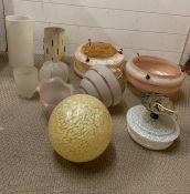 A selection of various glass lampshades