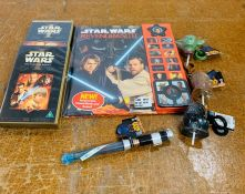 A selection of Star Wars collectables to include a book, dvd and keyrings etc