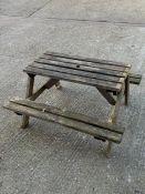 A wooden picnic bench AF