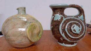 A pair of pottery vases and a charger by Gorbon Isil (signed: Mural?), a Burleigh Ware and another
