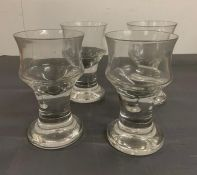 Four large goblet style glasses on steams