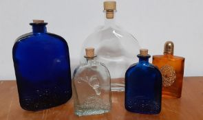 A collection of five empty glass bottles, (21.5 cm largest). (5)