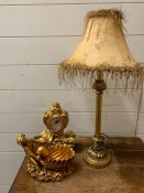 A selection of items to include clock, cherub themed dish and a lamp.