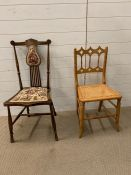 Two chairs, one with cane seat and carved spindle back and the other mahogany with splat back