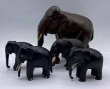 Four carved elephant figures