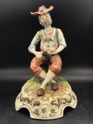 A Capodimonte figure of a country man