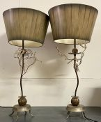 A pair of metal table lamps