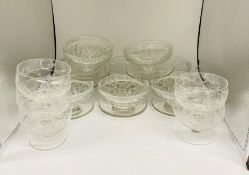 A mixed selection of cut glass dessert dishes