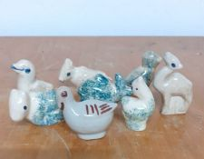 A group of eight ceramic animals, birds and sheep, (5 cm largest). (8)