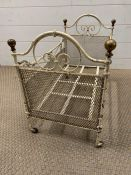 An early child's dolls cot with brass knobs to ends and castors (H40cm W56cm W32cm)