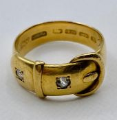 An 18ct gold belt themed ring with inset diamonds (Total Weight 7.2g) inscribed 1899.