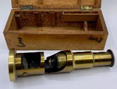 Brass, cased microscope