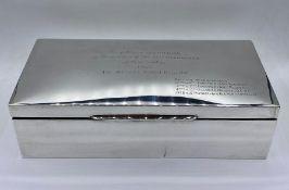 A Substantial silver cigarette box by Hamilton & Co of Calcutta (H7cm W24.5cm D12cm)