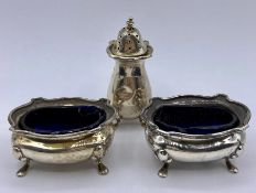 A set of hallmarked silver salts with blue glass liners AF Hallmarked Birmingham 1923.