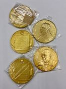 A selection of five medals designed by David Cornell and minted by the medallist John Pinches 22ct