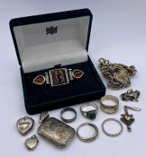 A selection of silver jewellery including charms, lockets and rings