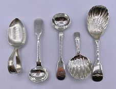 A selection of various silver spoons, with various hallmarks and makers.