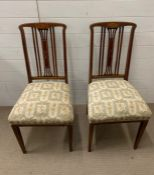 A pair of satinwood string inlay chairs