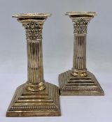A pair of silver column themed Mappin & Webb candlesticks, hallmarked.15cm H