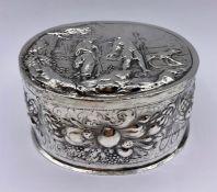 A Dutch silver lidded repousse decorated lidded pot.