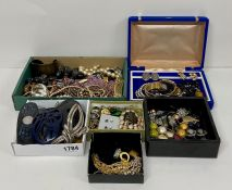 A substantial box of costume jewellery to include necklaces, hair clips, earrings, necklaces etc