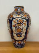 A Substantial 18th Century / 19th Century Imari vase with extensive repairs.