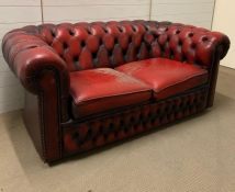 Two Seater button back Chesterfield in oxblood