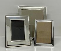 A Selection of three silver plated photograph frames.