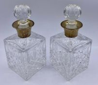 A Pair of Mappin & Webb silver collared liqueur decanters, hallmarked 1984