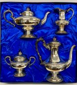 A Boxed Cavalier silver plated, hand chased tea service