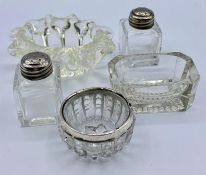 A selection of glass salts, various styles and one with a silver hallmarked rim.