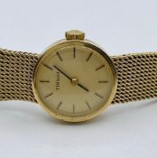 A Ladies Tissot watch on a 9ct gold, hallmarked strap total weight is (32.6g)