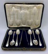 A 1935 cased silver teaspoon and sugar nip set by P Bros.