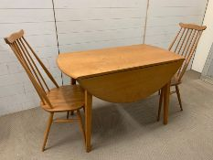 An Ercol dining table and No 369 Goldsmith chairs