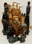A Large selection of carved wooden items, to include, African, Oriental and Asian.