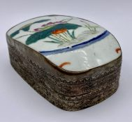A White metal and Chinese porcelain pot