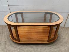 A Mid Century teak glass top coffee table on castors (H40cm W90cm D50cm)