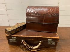 A small leather suitcase, desk tidy and pen holder
