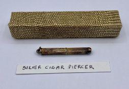 A silver cigar piercer