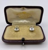 A cased set of 18 ct gold and diamond shirt studs.