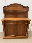 A small sideboard or serving table with barley twist pillars and cupboard to base (H136cm W103cm